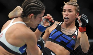 December 10, 2015; Las Vegas, NV, USA; Kailin Curran lands a kick against Emily Kagan during UFC Fight Night at The Chelsea at the Cosmopolitan. Mandatory Credit: Gary A. Vasquez-USA TODAY Sports