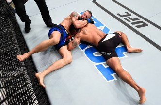 HOUSTON, TX - FEBRUARY 04: (L-R) James Vick attempts to submit Abel Trujillo in their lightweight bout during the UFC Fight Night event at the Toyota Center on February 4, 2017 in Houston, Texas. (Photo by Jeff Bottari/Zuffa LLC/Zuffa LLC via Getty Images)