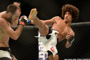 Jun 4, 2016; Los Angeles, CA, USA; Alex Caceres (blue) fights Cole Miller (red) during UFC 199 at The Forum. Mandatory Credit: Jake Roth-USA TODAY Sports