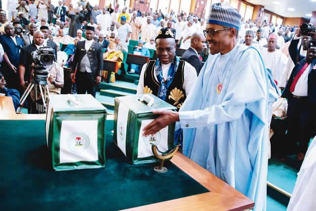 Image result for President Muhammadu Buhari presenting the 2018 budget to the National Assembly in Abuja... on Tuesday. Photo: Olatunji Obasa