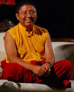 Tsoknyi Rinpoche on couch.