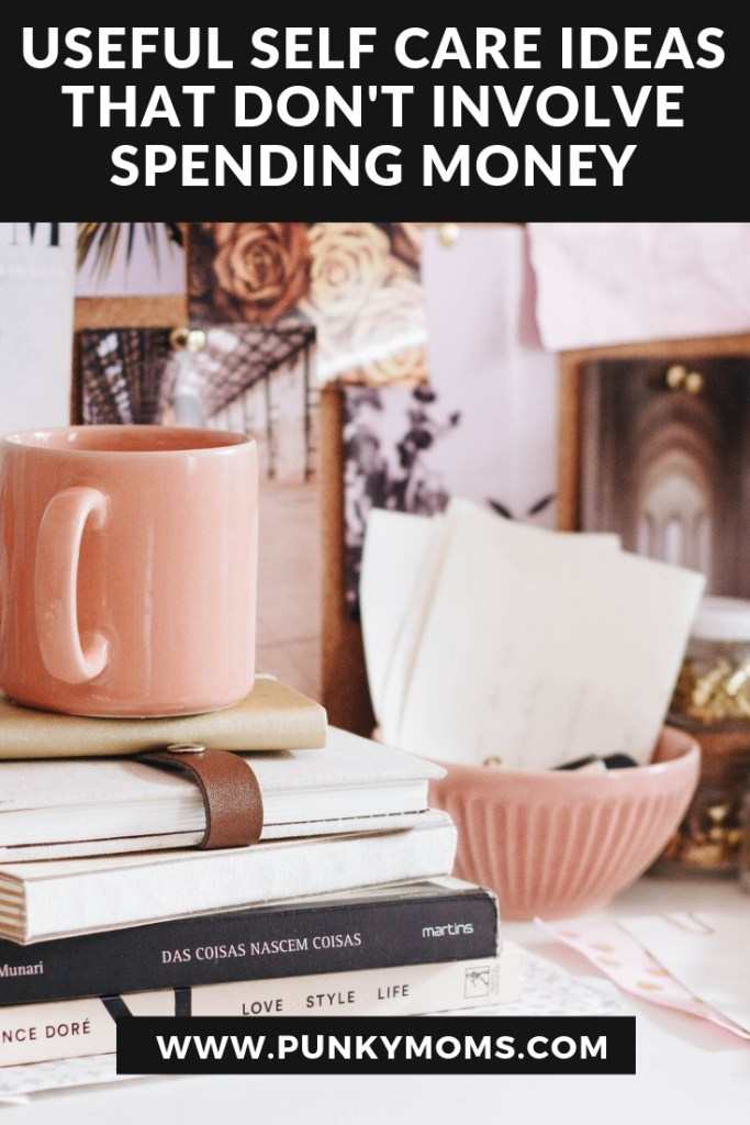 Here are 40 self-care ideas that don't cost anything, because you shouldn't have to spend money to feel good. Image description of pink mug and books on top of a desk.