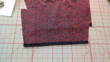 Sleeves and neck are finished with bias tape. Lovely!