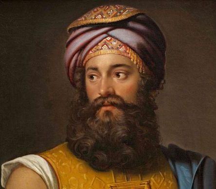 foto di giovanni battista belzoni con la barba lunga e uno scialle in testa, occhi dolci e sguardo verso il basso