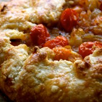 cherry tomato-caramelized onion crostata