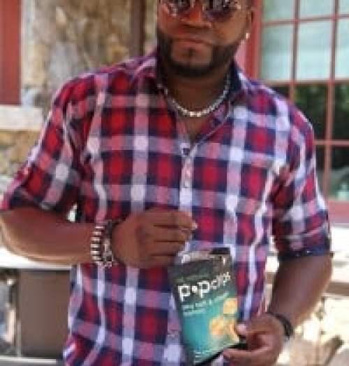 David Ortiz holding a bag of Popchips