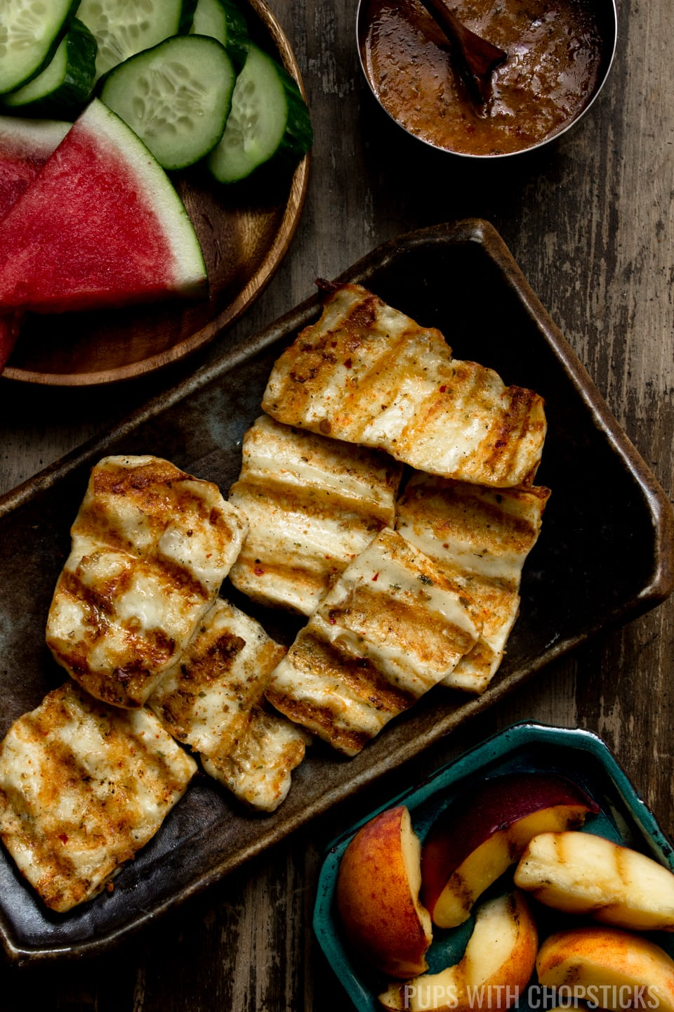 A grilled halloumi cheese recipe, marinated in a spiced basil chili oil and finished off with maple syrup