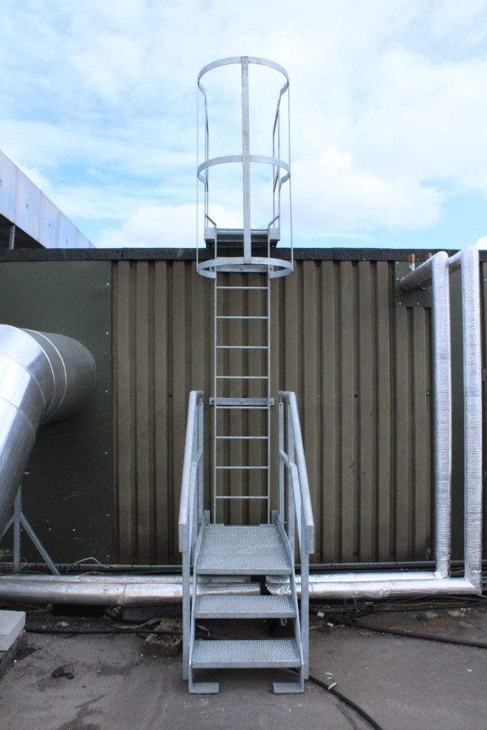 Mild steel galvanised safety ladder with cage and access platform