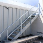 Mild steel galvanised stairs with balustrade and step over