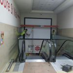 6 - Steel being lowered further down the escalator