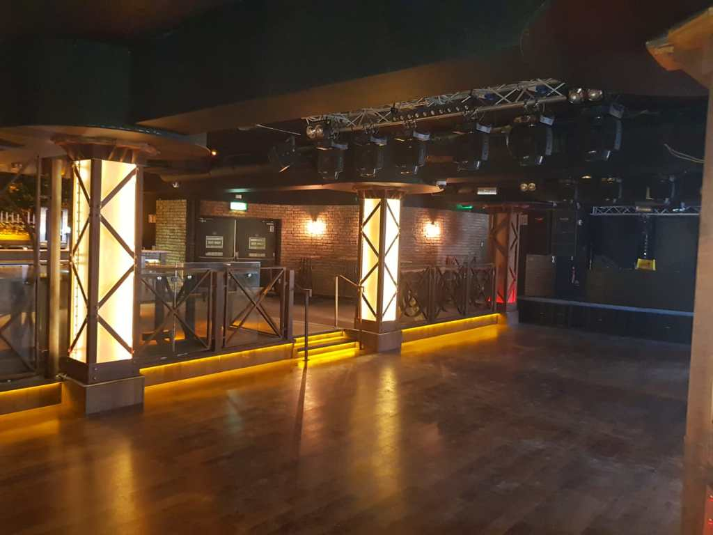 Bespoke dance floor railing and light pillars with steel surround
