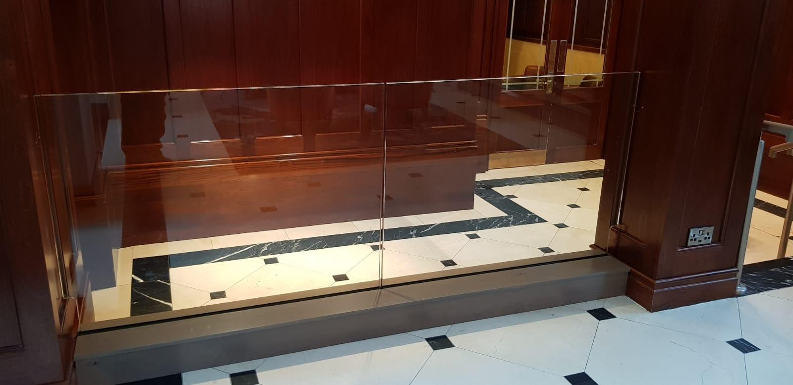 Reception area glass railing