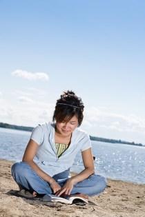 Girl reading on beach