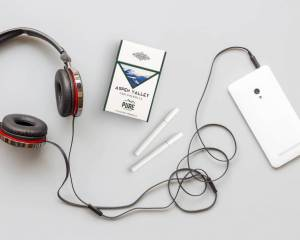 Some Aspen Valley Hemp Company Cigarettes sitting next to some headphones