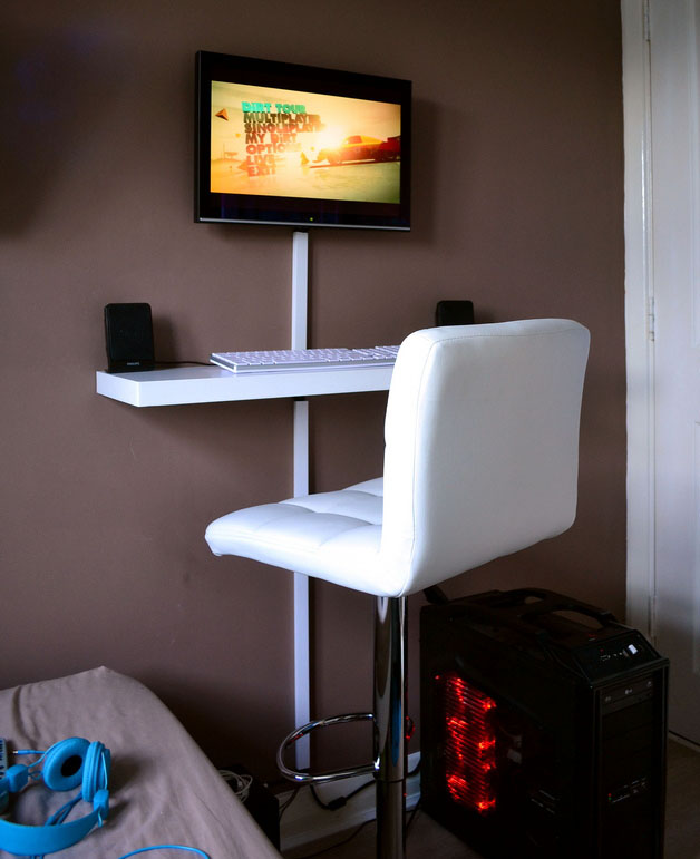 ... A Floating Shelf That Perfectly Fits A Full Size Keyboard, Mouse, And A  Pair Of Computer Speakers, And A Bar Stool That He Uses As A Desk Chair.