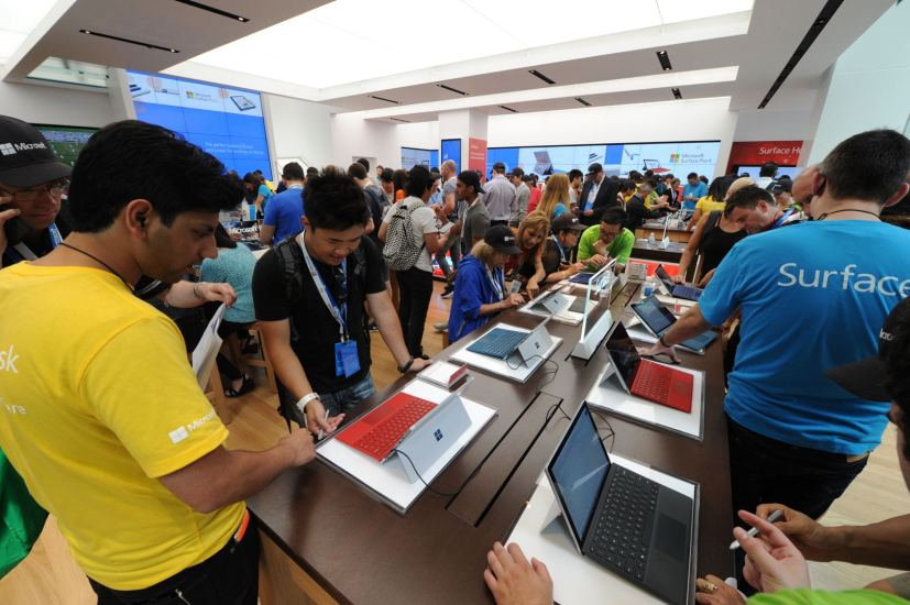 Microsoft Store with a lot of people using Surface devices