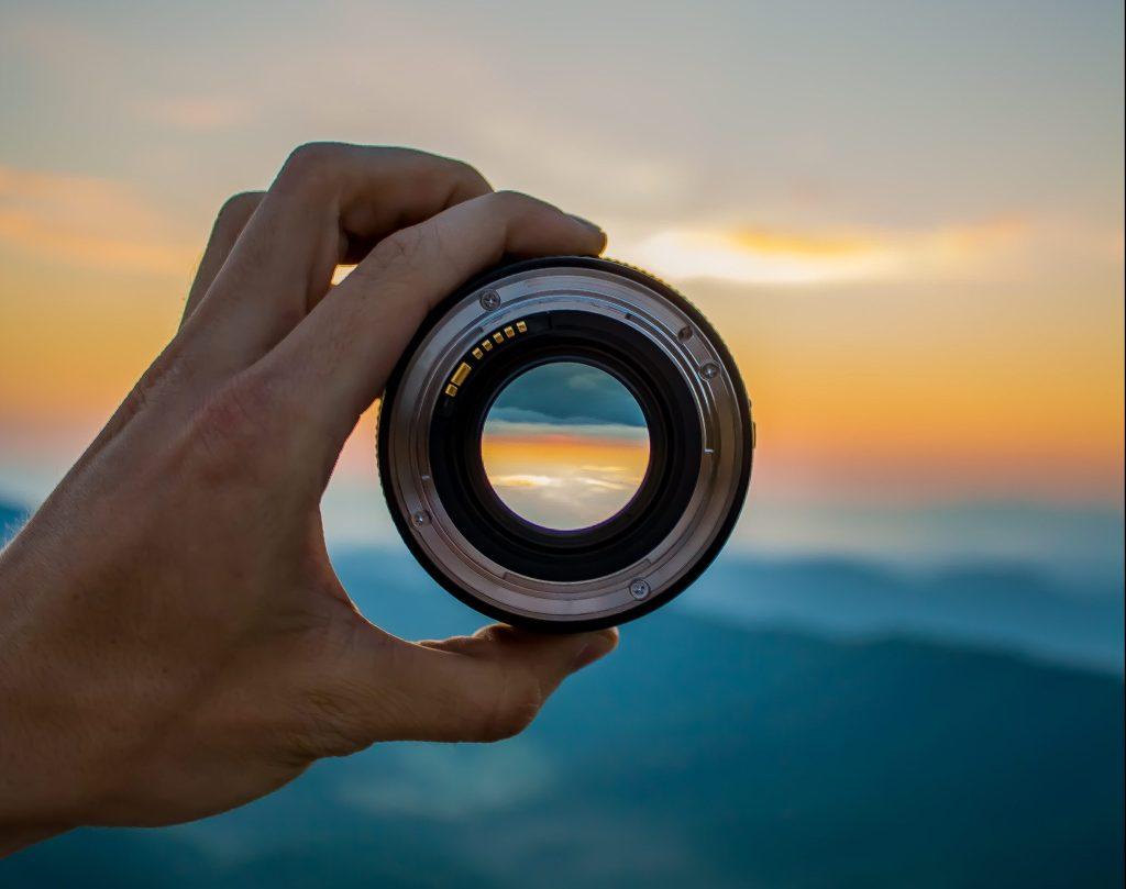 camera-lens-clouds-hand-1208074