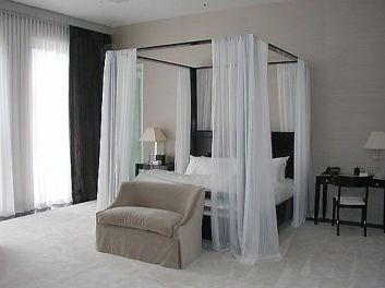 I have always loved the idea of a canopy bed.