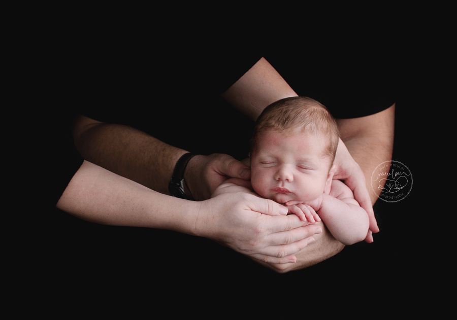 sleeping-newborn-photography-baby-in-dad-mom-arms_STF9523