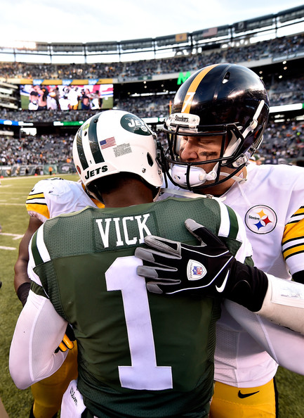 9f07bf4bd62 Quarterback Michael Vick  1 of the New York Jets meets quarterback Ben  Roethlisberger  7 of the Pittsburgh Steelers after winning 20-13 in a game  at MetLife ...