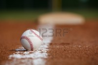 17729191-baseball-on-the-infield-chalk-line-with-the-base-in-the-distance