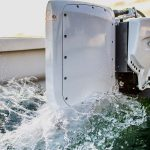 Pure Watercraft white Electric Outboard Motor in water