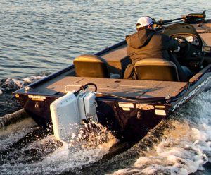 Man driving electric powered fishing boat