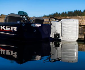 Electric outboard motor on Tracker bass boat in still water