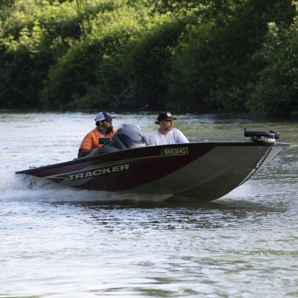 Bass boat speeding with two passengers
