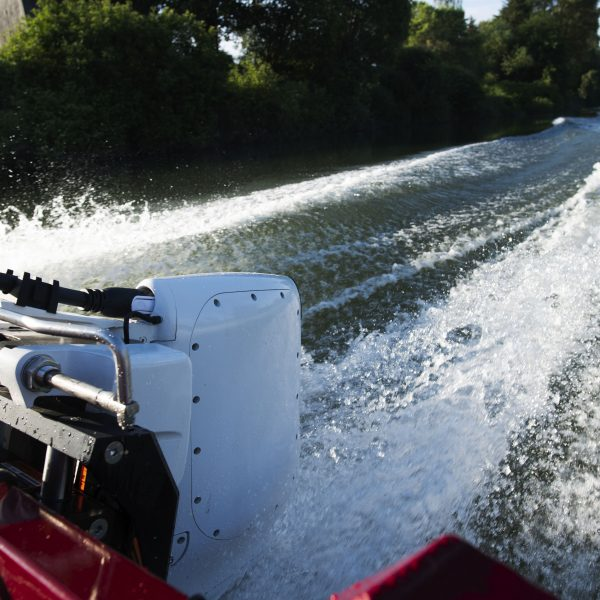 Electric outboard motor pushing boat at high speed