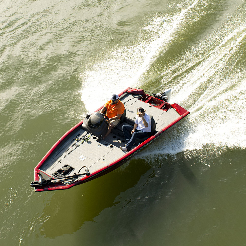 Overhead view of two men driving electric fishing boat