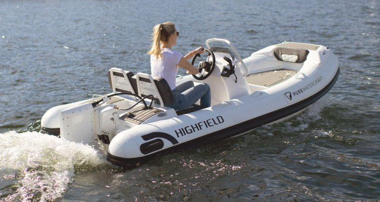 Woman driving electric powered rigid inflatable boat