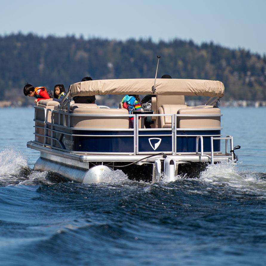 Kids on electric pontoon boat