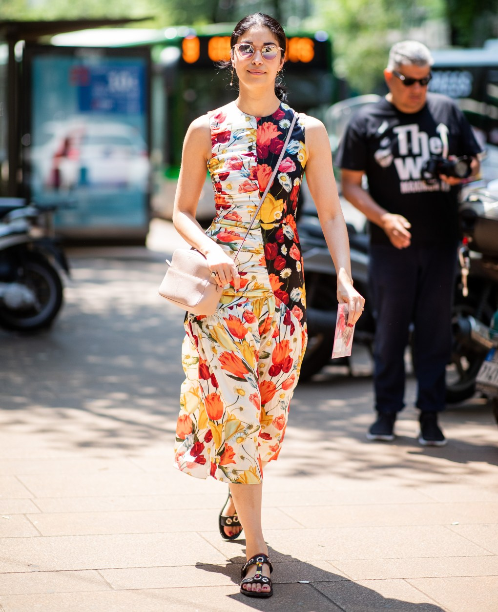 woman wearing a fitted midi dress