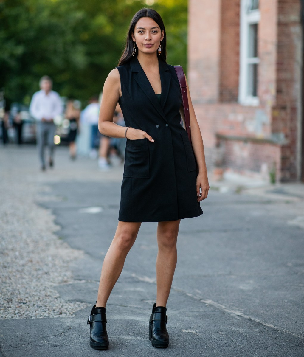 woman wearing a v neck black dress