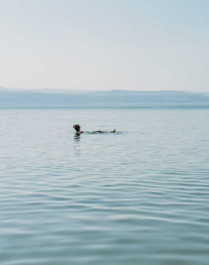 woman floating in the dead sea