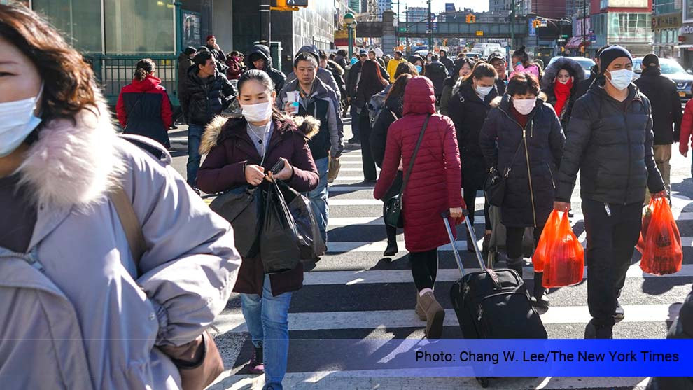 new york cross walk with people on mask