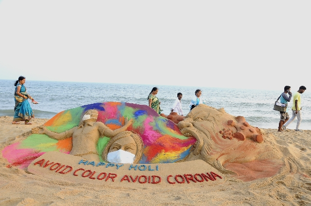 Celebrate Holi without Color Awareness About Corona Virus through his Sand Art