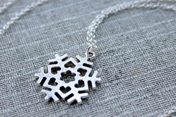 Silver snowflake love necklace, minimalist jewelry design by Liz @PurlsAndPixels