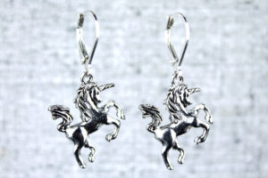 Silver unicorn earrings photograph by Liz @PurlsAndPixels