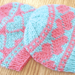 Handmade twin baby gift set of matching baby hats with heart design. Hand-knit by Liz @PurlsAndPixels.