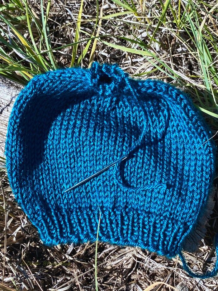 Learn to bind off hats that are knit in the round by drawing the yarn tail through the remaining stitches - a knitting lesson with Liz Chandler @PurlsAndPixels.