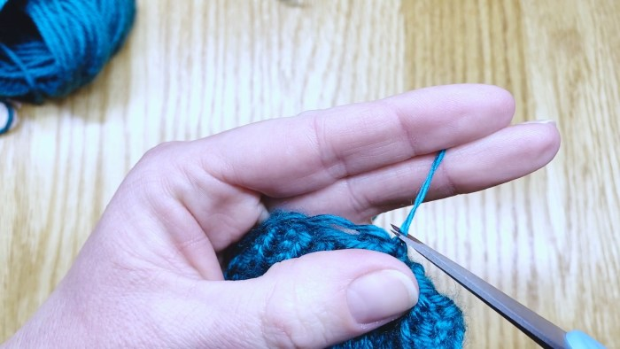 Step 20: Weave in cast on tail for round knitting projects - a lesson with Liz Chandler @PurlsAndPixels.