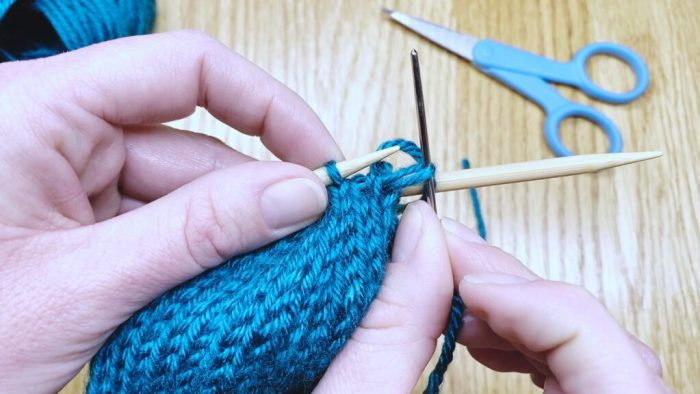 Step 4: Draw yarn through remaining stitches to bind off knits in the round - a lesson with Liz Chandler @PurlsAndPixels.