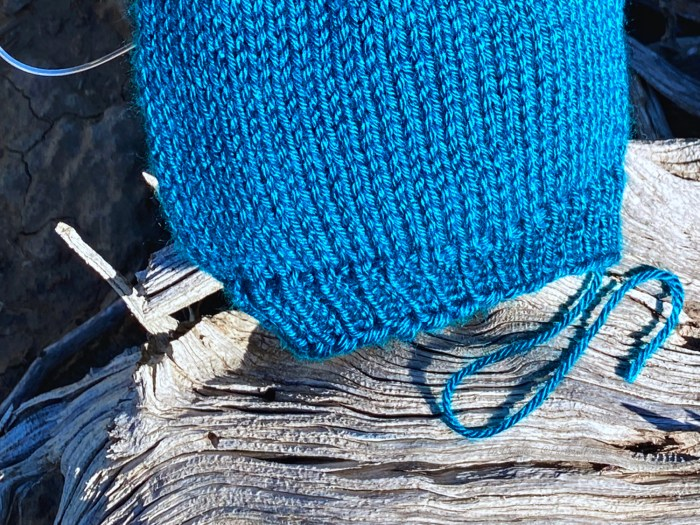 Learn to finish the cast on edge of hats that have been knit in the round from the bottom up - a knitting lesson from Liz Chandler @PurlsAndPixels.