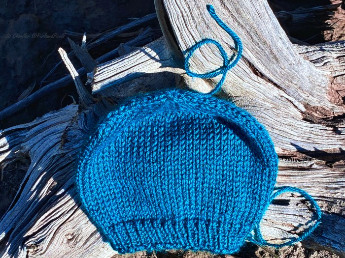 Learn to weave in the loose end at the tops of hats that have been knit in the round from the bottom up - a knitting lesson from Liz Chandler @PurlsAndPixels.