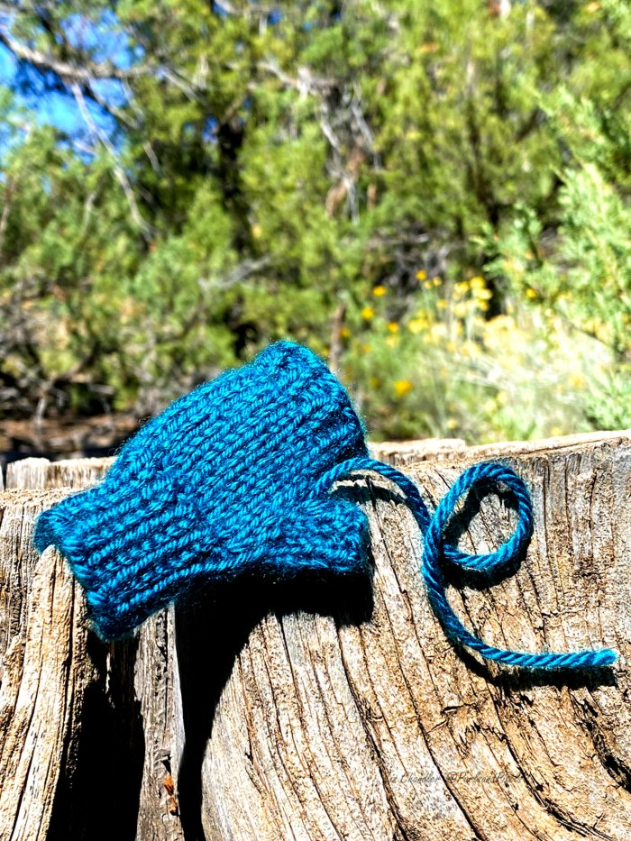 Learn to weave in the tail at the base of a glove thumb and close the gap with duplicate stitch in this knitting lesson from Liz Chandler @PurlsAndPixels.