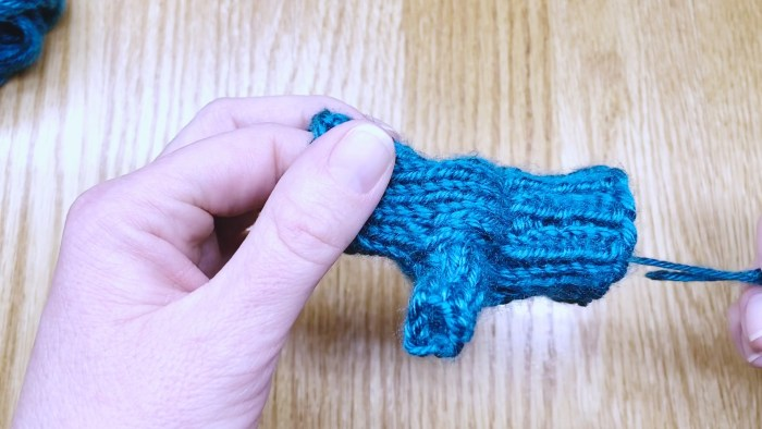 Step 21: Weave in the loose end at the base of a fingerless glove thumb - knitting lesson with Liz Chandler @PurlsAndPixels.