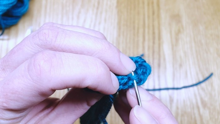 Step 3: Weave in the cast-on tail of fingerless gloves - a knitting lesson from Liz Chandler @PurlsAndPixels.
