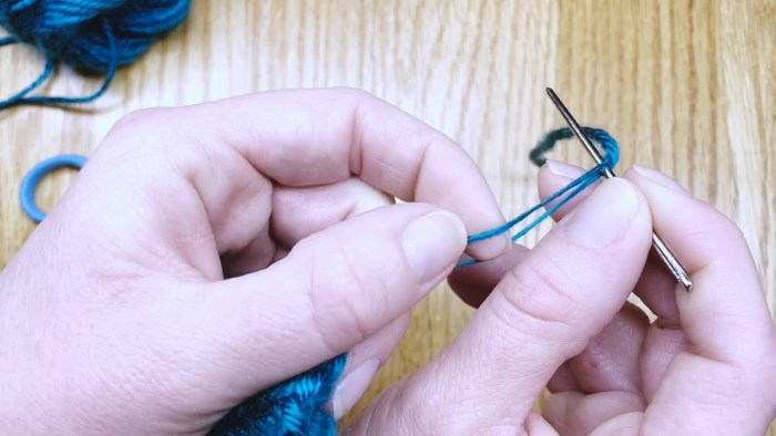 Step 13: Weave in the cast-on tail of mittens - a knitting lesson from Liz Chandler @PurlsAndPixels.